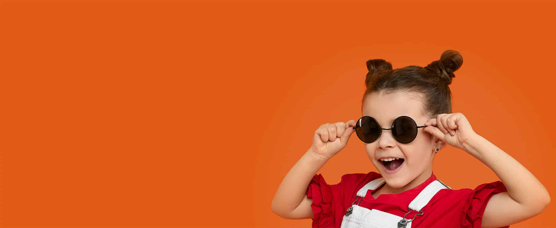 Little girl holding sunglasses